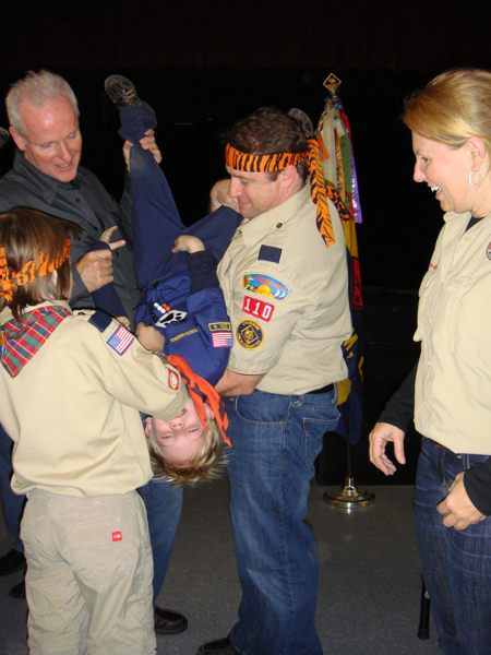 daddy-pinning-bobcat-badge-on-aidan